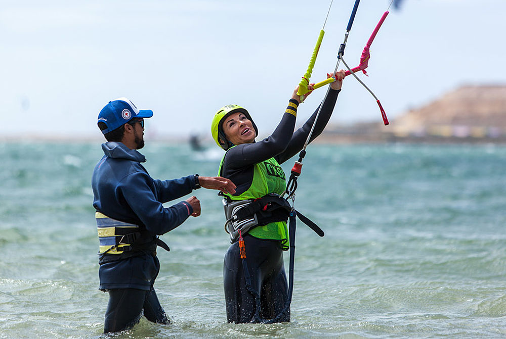 Kitesurf instructor and student in hip deep water