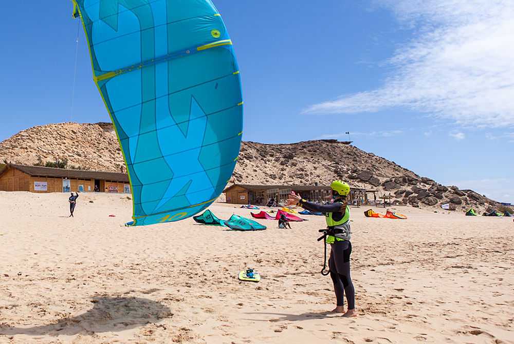 Launching a kite at the kitebeach at KBC Dakhla