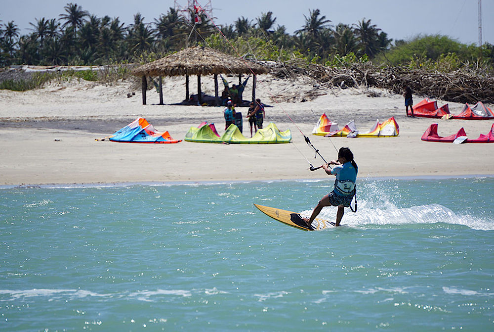 kitesurfing girl with waveboard in Brazil