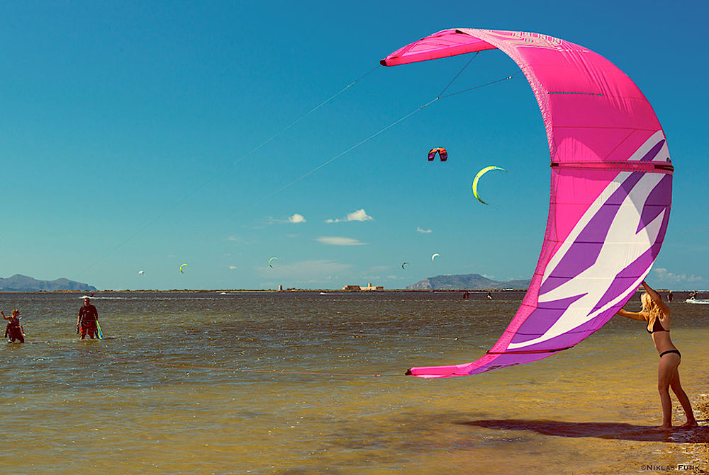 Kitesurfing girl at kitebeach Sicily